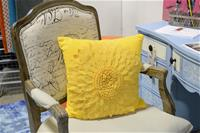 Yellow pillow on chair
